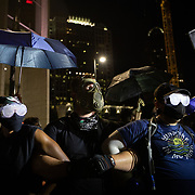 CHARLOTTE, NC - August 22:  Protestors form a human chain during a protest, organized by Charlotte Uprising in uptown Charlotte near the site of the 2020 Republican National Convention in uptown Charlotte on August 22, 2020.  Delegates are holding private meetings inside the convention center ahead of the official start of the paired down convention on August 24th. (Photo by Logan Cyrus for AFP)
