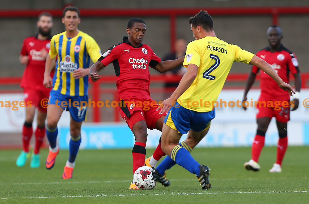 Crawley's Lewis Young challenges Matty Pearson of Accrington during the Sky Bet League 2 match between Crawley Town and Accrington Stanley at the Checkatrade Stadium in Crawley. October 22, 2016.<br /> James Boardman / Telephoto Images<br /> +44 7967 642437