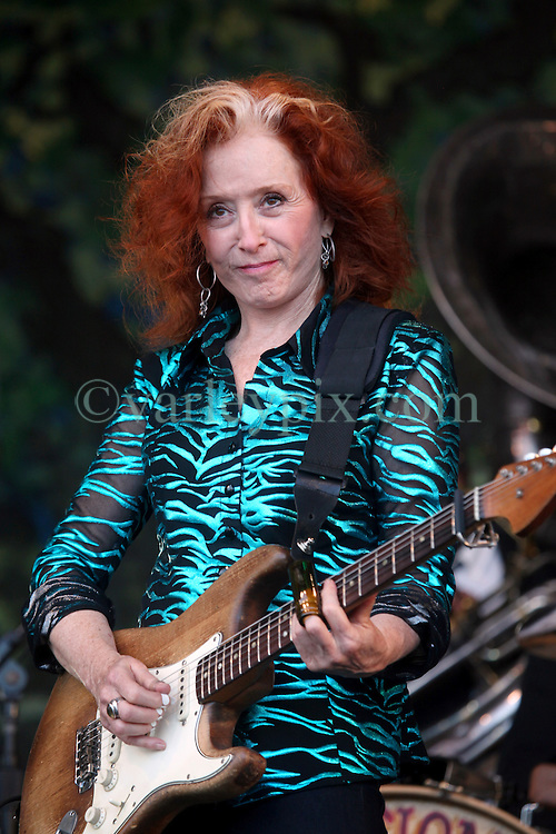 05 May 2012. New Orleans, Louisiana,  USA. .New Orleans Jazz and Heritage Festival. .Bonnie Raitt, 9 time Grammy award winner plays with 'Preservation Hall and Friends' ensemble. .Photo; Charlie Varley.