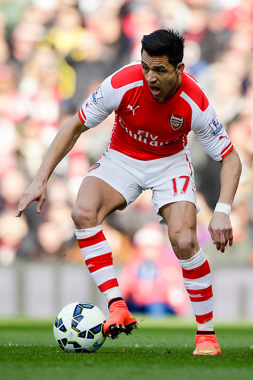 Arsenal's Alexis Sanchez in action during todays match  <br /> <br /> Photographer Craig Mercer/CameraSport<br /> <br /> Football - Barclays Premiership - Arsenal v West Ham United - Saturday 14th March 2015 - Emirates Stadium - London<br /> <br /> © CameraSport - 43 Linden Ave. Countesthorpe. Leicester. England. LE8 5PG - Tel: +44 (0) 116 277 4147 - admin@camerasport.com - www.camerasport.com