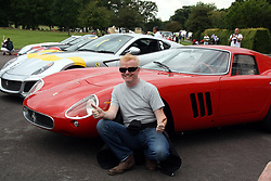Chris Evans poses in front of a classic Ferrari in Longleat Safari Park during a charity event in aid of Children in Need.