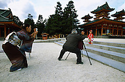 A mother captures the moment when a photographer takes a picture of her daughter after she has gone through the shichi-go-san ceremony at the Heian Jingu shrine, in Kyoto, Japan. During shichi-go-san, literally seven-five-three, parents dress their daughters aged three and seven and sons aged five in traditional costume and take them to a Shinto shrine to be blessed.