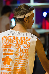 """© Licensed to London News Pictures . 21/10/2012 . Manchester , UK . A student with """" Savile """" written on his Carnage UK t-shirt . Students attend a Carnage UK pub crawl at bars in Manchester 's Deansgate Locks with a fancy dress theme of """" Pimps and Hoes """" . The event has been criticised for encouraging binge drinking , sexism and anti-social behaviour . Photo credit : Joel Goodman/LNP"""