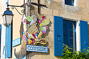 Sign for ice cream and confiserie confectionery shop in Coulon in the Marais Poitrevin region, France