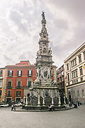 """The Spire or Guglia of the Immaculate Virgin in Naples, southern Italy. The Guglia dell'Immacolata is a monument that stands in the square in front of the church of Gesù Nuovo. It is the tallest and most ornamental of three such """"plague columns"""" in Naples."""