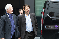 "© Licensed to London News Pictures. 20/10/2016. LONDON, UK.  Carl Rogberg (centre), British supermarket giant Tesco's former UK finance director arrives at Southwark Crown Court for a plea hearing. Three former senior executives of Tesco: Carl Rogberg, Chris Bush and John Scouler are charged as part of a Tesco accounting scandal, with one count of fraud by abuse of position and one count of false accounting and are alleged to have ""dishonestly falsified"" the accounts. The supermarket's former finance chief, managing director and food commercial head were investigated by the Serious Fraud Office (SFO) for their alleged role in the accounting scandal in which Tesco was found to have inflated its profits in 2014.  Photo credit: Vickie Flores/LNP"