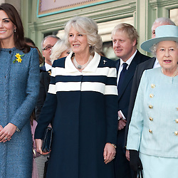 .HM The Queen accompanied by The Duchess of Cornwall and The Duchess of Cambridge today visited  Fortnum and Mason in London.They visited the Food hall where they viewed tins of tea and biscuits on display for the Gifts for Troops scheme.Pic Shows Hm The Queen standing with The Duchess of Cornwall and The Duchess of Cambridge