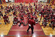 """ORADELL, NJ - October 17: In what would have normally been a locker room setting, Coach Vito addresses team in their gymnasium before their first home game on at their new renovated field, """"The Jack"""".<br /> <br /> We are in the midst of witnessing something this world has never experienced - a global pandemic. The coronavirus has swept away the world in March of 2020 - since then, the world we know It hasn't been the same. Jobs, businesses and futures have been put on hold and lost, yet, we have to power through to overcome one of the greatest obstacles this we have faced. The high school football season wasn't suppose to happen, but a glimmer of hope, intense safety measures & a little bit of luck has allowed for the season to start, now the question is ' Can It be completed?'<br /> <br /> Photo by Johnnie Izquierdo"""