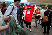 Human post box. The Art Car Boot Fair in a car park just off Brick Lane in East London. This is an alternative art event where artists show their works and engage with the public. The Art Car Boot Fair was an idea that grew out of a desire to re-introduce some summer fun and frivolity into a thriving but increasingly commercial London art scene. The aim for the Art Car Boot Fair is to be a day when the artists let their hair down and for all-comers to engage with art in a totally informal way, and to pick up some real art bargains.