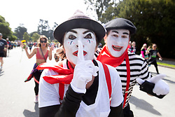 A pair of mimes mug for the camera at the 107th running of the Bay to Breakers, Sunday, May 20, 2018, in San Francisco. (Photo by D. Ross Cameron)