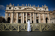 A nun prays in front of St. Peter's Basilica in St. Peter's Square during the first day of conclave and the selection of the new Pope in Vatican City, March 12, 2013. Photograph by Todd Korol