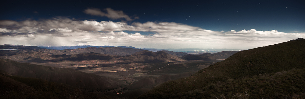 The Anza-Borrego desert on a moonlit night while on the road to Julian. The Salton Sea can be seen in the distance.