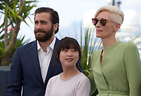 Jake Gyllenhaal, Ahn Seo-Hyun and Tilda Swinton at the Okja film photo call at the 70th Cannes Film Festival Friday 19th May 2017, Cannes, France. Photo credit: Doreen Kennedy