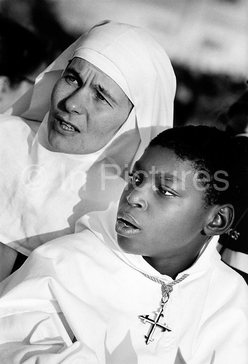 Pope's visit to France. A nun and a young novice in the crowd listening to the Pope. 150,000 people gather at an open air mass at St Anne D'Auray. September 19996, France