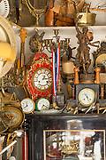 Vintage merchandise with antique clocks for sale at antique market in Casablanca, Morocco