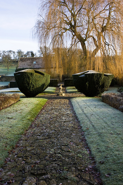 Frost covered country garden, Swinbrook, The Cotswolds, Oxfordshire, England, United Kingdom