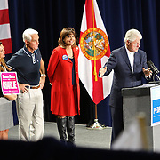 Former President Bill Clinton, far right, with Florida Democratic gubernatorial candidate Charlie Crist, second from left, Carole Crist, left, and running mate Annette Taddeo, second from right, attend a campaign event, Monday, Nov. 3, 2014, in Orlando, Fla. Crist, a former Florida Republican governor, is running against Republican Florida Gov. Rick Scott.  (AP Photo/Alex Menendez)