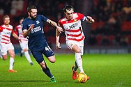 John Marquis of Doncaster Rovers (9) takes on John White of Southend United (48) during the EFL Sky Bet League 1 match between Doncaster Rovers and Southend United at the Keepmoat Stadium, Doncaster, England on 12 February 2019.