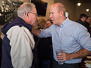03 JANUARY 2020 - MONTEZUMA, IOWA: JOHN DELANEY talks to a man after speaking at a campaign stop in a cafe in Montezuma, IA. Delaney, a former Democratic Congressman from Maryland, was the first Democrat to declare his candidacy for President in 2020, He has held more than 400 campaign events in Iowa since declaring his candidacy. Iowa traditionally holds the first selection event of the presidential election cycle. The Iowa Caucuses are Feb. 3.    PHOTO BY JACK KURTZ