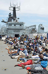 Royal Marines from HMS Bulwark help rescue migrants stranded on a boat, thirty miles off the Libyan coast.