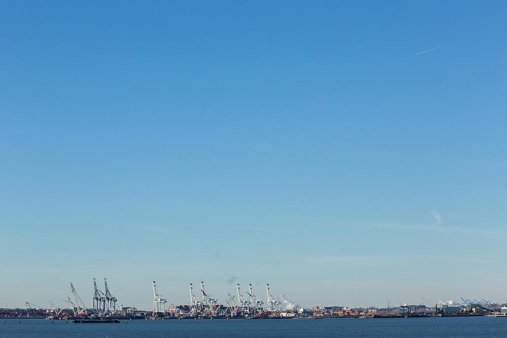 Liberty Island, NY - 9 January 2020. Port Elizabeth, NJ, with its cranes, seen from Liberty Island.