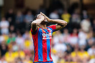 frustrated Wilfried Zaha (11) of Crystal Palace,   during the Premier League match between Watford and Crystal Palace at Vicarage Road, Watford, England on 21 April 2018. Picture by Sebastian Frej.