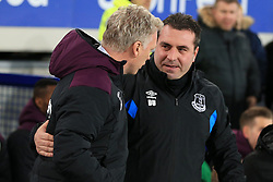 Everton caretaker manager David Unsworth and West Ham manager David Moyes during the Premier League match at Goodison Park, Liverpool.