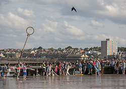 Later in the day alongside the Portobello Big Beach Busk there was a Beach Rocket competition on the sands organised by Portobello Community Council. All shapes and sizes of home made plastic bottle rockets, powered only by water and an air pump, arced over the sand, watched by a large crowd. <br /> <br /> <br /> © Jon Davey/ EEm