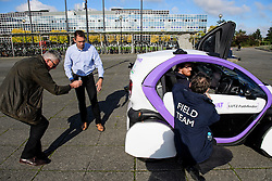 © London News Pictures. 11/10/2016. Milton Keynes, UK. Dr Graeme Smith, CEO and chairman of Oxbotica (second left, blue shirt)) watches over as driverless cars are tested around pedestrian areas in Milton Keynes in the first public test of autonomous electric vehicles in the UK. The vehicles have been developed by the Oxford Robotics Institute and Oxbotica. Photo credit: Ben Cawthra/LNP