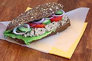 Tuna salad sandwich with tomato and cucumber