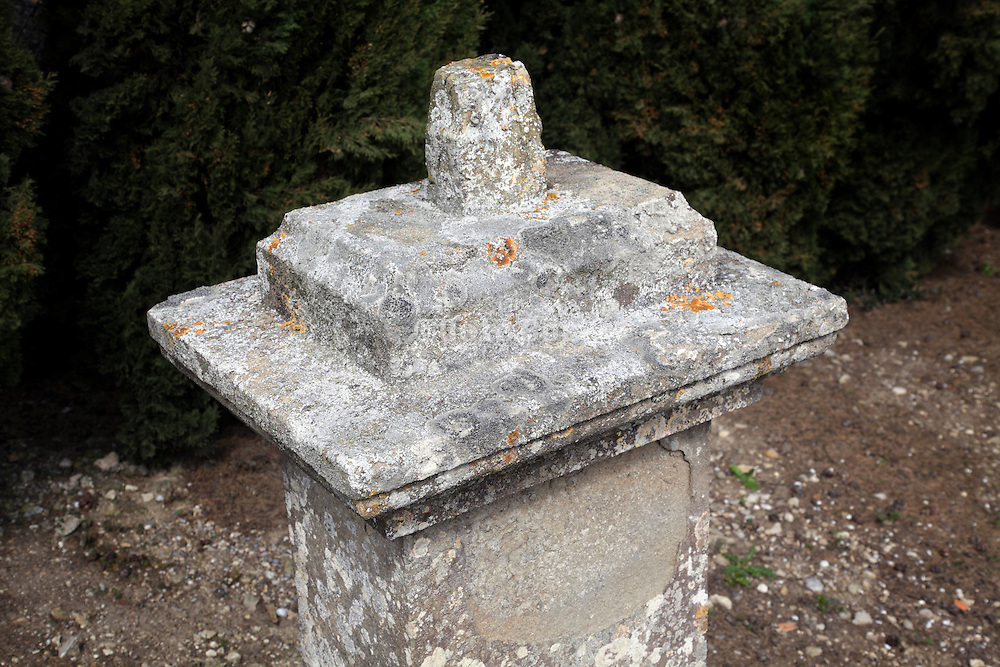 graveyard memorial pillar with missing cross