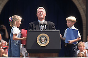 President Bill Clinton laughs as he is introduced by school children during a campaign stop for his re-election August 27, 1996 in Wayandotte, MI