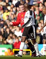 Photo: Daniel Hambury.<br />Fulham v Manchester United. The Barclays Premiership. 01/10/2005.<br />Fulham's Luis Boa Morte is calmed down by  Manchester Utd's Wayne Rooney.
