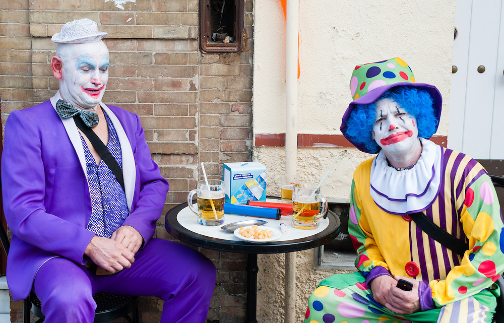 Two clowns having a beer and tapas in Sevilla (Spain)