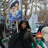 Tehran. Iran. 38th anniverssary of the islamic revolution. Parade and political demonstration on englabe and Azadi avenue to Azadi tower for the