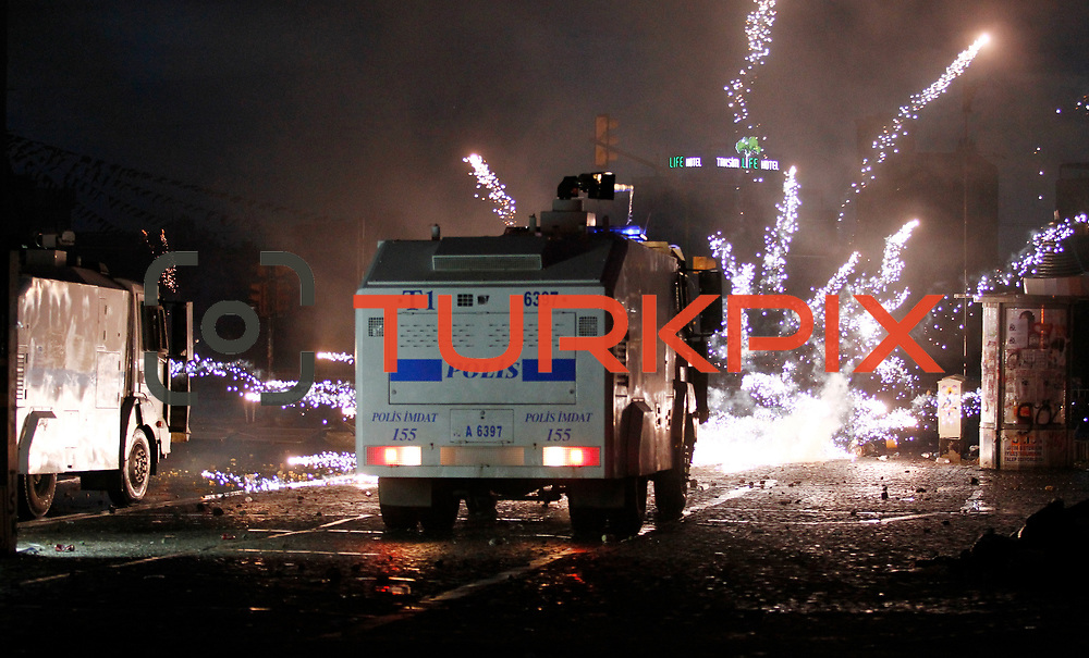 Turkish police use tear gas to disperse protestors during a clash at Taksim Square in Istanbul, Turkey, 11 June 2013. Turkey's crackdown on opposition protesters reportedly left at least two dead and more than 1,000 injured. Photo by AYKUT AKICI/TURKPIX