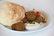A plate falafel balls (deep fried ground chickpea) Tahini salad and pita