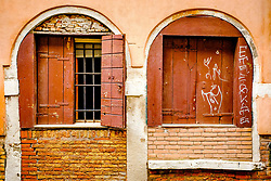 Shuttered windows overlooking a canal in Venice, Italy<br /> <br /> (c) Andrew Wilson | Edinburgh Elite media