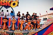 Oct. 21, 2009 -- PHOENIX, AZ: People ride the Disko on the midway at the Arizona State Fair in Phoenix, AZ. The fair runs through November 8.   Photo by Jack Kurtz