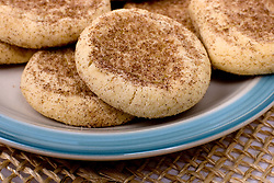 13 January 2012:   fresh baked snicker doodle cookies displayed on a stoneware platter