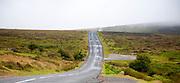 Empty road crossing moorland near Postbridge, Dartmoor national park, Devon, England, UK