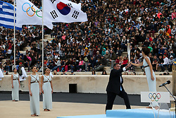 ATHENS, Oct 31, 2017  Greek actress Katerina Lehou (1st R) in the role of an Ancient Greek High Priestess passes the Sacred Olympic Flame to Hellenic Olympic Committee President Spyros Capralos at Panathenaic stadium in Athens on Oct. 31, 2017,during the handover ceremony of the Olympic flame for the 2018 Winter Olympics in Pyeongchang, South Korea. (Credit Image: © Marios Lolos/Xinhua via ZUMA Wire)