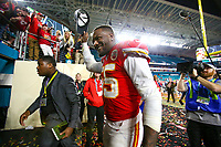 Kansas City Chiefs defensive end Frank Clark (55) tips his cap to the fans after the NFL Super Bowl 54 football game between the San Francisco 49ers and Kansas City Chiefs Sunday, Feb. 2, 2020, in Miami Gardens, Fla.<br /> <br /> ( Tom DiPace via AP)
