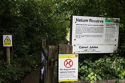 Calvert, UK. 27 July, 2020. A sign indicates the entrance to Calvert Jubilee Nature Reserve. On 22nd July, the Berks, Bucks and Oxon Wildlife Trust (BBOWT) reported that it had been informed of HS2's intention to take possession of part of Calvert Jubilee nature reserve, which is home to bittern, breeding tern and some of the UK's rarest butterflies, on 28th July to undertake unspecified clearance works in connection with the high-speed rail link.