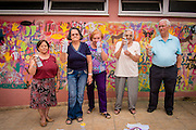 08/09/2015 - Lisbon, Portugal: Olinda Rodrigues, 66, in front of the wall that was painted during the Lata 65 workshop. Lata 65 was project created by Lara Seixo Rodrigues and is a creative workshop teaching street art to senior citizens. (Eduardo Leal)