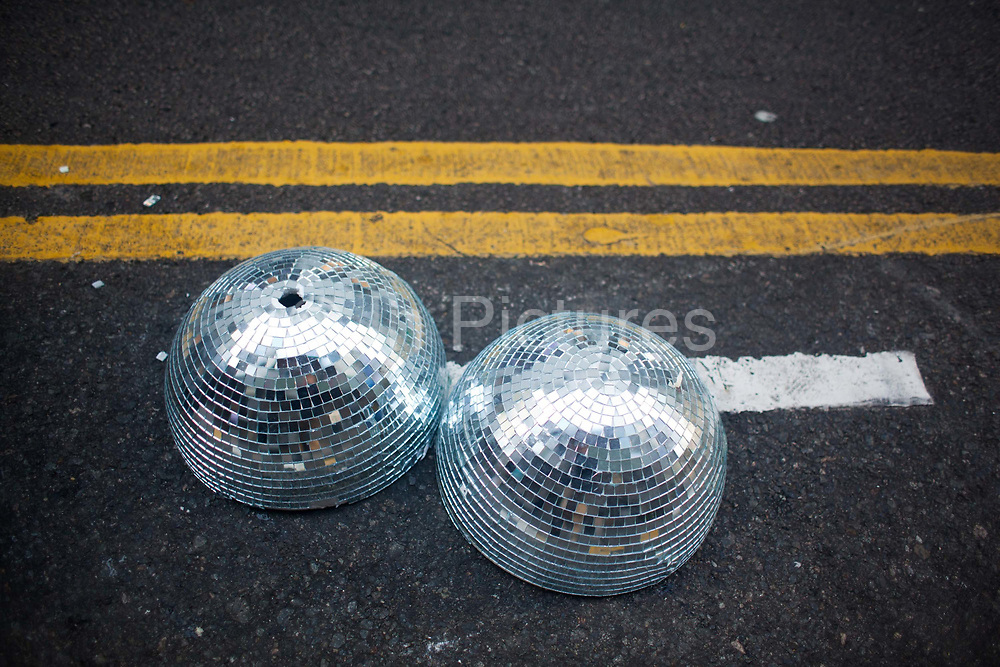 A mirror disco ball lies broken in the road in Central district.