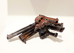 02 October 2014. Jonathan Ferrara Gallery, New Orleans, Louisiana. <br /> Jonathan Ferrara Gallery. 'Guns In The Hands Of Artists' A piece by the artist Robert C Tannen. The show brings together over 30 internationally acclaimed artists who took parts from 190 destroyed weapons acquired by the New Orleans Police department  and converted them into art.  <br /> Photo; Charlie Varley/varleypix.com