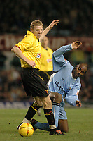 Fotball<br /> England 2004/2005<br /> Foto: SBI/Digitalsport<br /> NORWAY ONLY<br /> <br /> Coventry City v Watford <br /> Coca Cola championship. 18/12/2004<br /> <br /> Coventrys  Dele Adebola battles with watfords Brynjar Gunnarsson