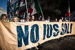 October 14, 2017 - Rome, Italy - Demonstrators hold a sign reading ''Enough immigration, Italians first!'' as they participate in a march in favour of labor and against irregular immigration staged by the National Movement for Sovereignty (Movimento Nazionale per la Sovranita). (Credit Image: © Andrea Ronchini/Pacific Press via ZUMA Wire)