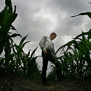 Webb Wallace stands in a row of a young corn crop while talking about the state of the Rio Grande Valley's agricultural industry in a field north of Weslaco.<br /> Nathan Lambrecht/The Monitor